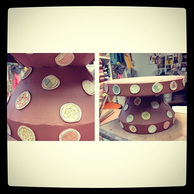 Working on NCECA pots. This cake stand will be somewhere in Milwaukee. #radasch #cakestand #pottery #stickers